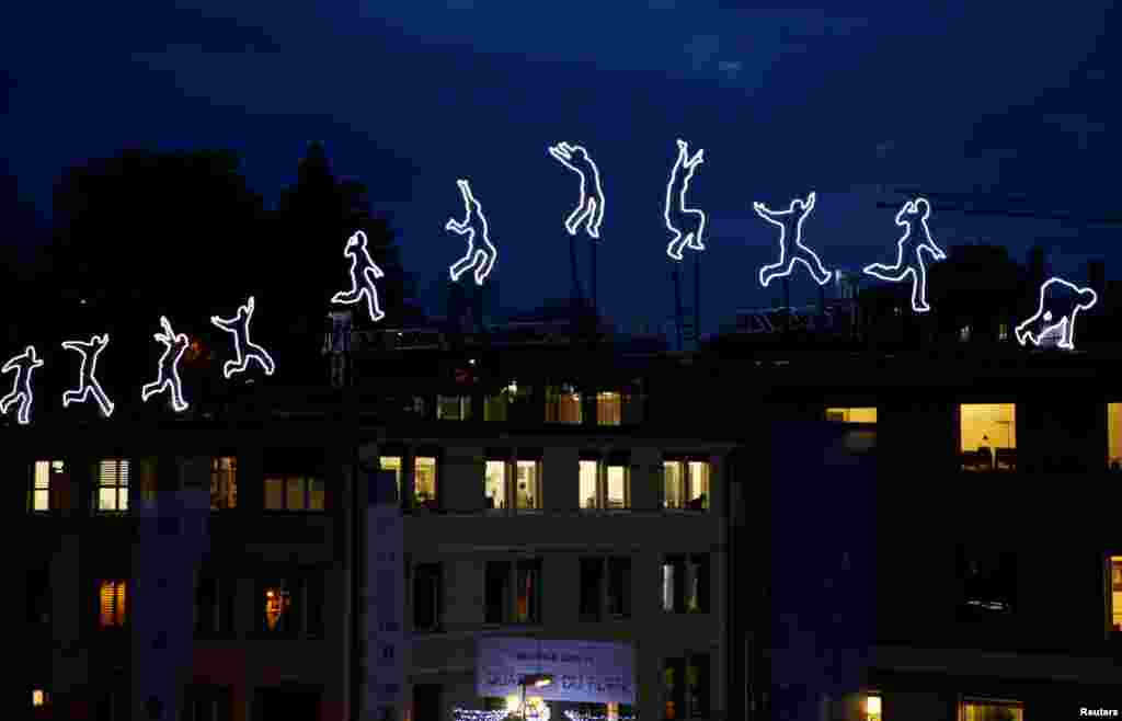 "The light installation ""Run Beyond"" by Angelo Bonello is pictured ahead of the opening of the Lausanne Lumieres light festival in Lausanne, Switzerland."
