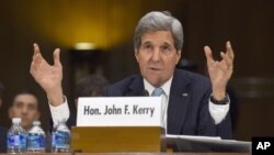 """Secretary of State John Kerry testifies on Capitol Hill, Dec. 9, 2014, before the Senate Foreign Relations hearing on """"Authorization for the Use of Military Force Against IS."""""""