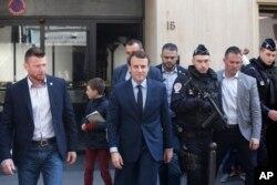 Emmanuel Macron leaves his Paris apartment Monday.