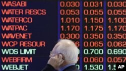 A man talks on his cellular phone at the Australian Stock market in Sydney, August 9, 2011