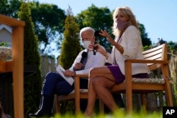 Democratic presidential candidate former Vice President Joe Biden and his wife Jill Biden meet with people in a backyard as they discuss school reopening with local parents and educators in Wauwatosa Wis., Thursday, Sept. 3, 2020. (AP Photo/Carolyn Kaster
