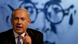 Israeli Prime Minister Benjamin Netanyahu delivers a speech to his Likud party members in Tel Aviv, Israel, Sunday, May 6, 2012.