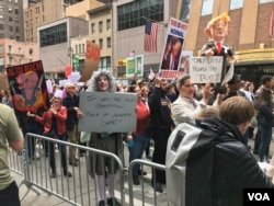 Signs are displayed at the New York City march, where protesters called on President Donald Trump to release his tax returns, April 15, 2017.