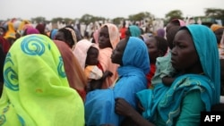 This photo taken on June 15, 2012, at the Jamam refugee camp, shows mothers queueing at a Medecin Sans Frontiere (MSF) field hospital in South Sudan's Upper Nile state, where over 100,000 refugees have fled conflict in Sudan's Blue Nile state since Sept.