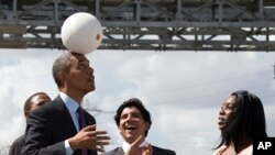 "U.S. President Barack Obama demonstrates ""the Soccket Ball,"" which uses kinetic energy to provide power in Africa. (File)"