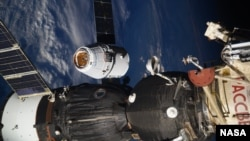 In this photo taken by Russian astronaut Sergey Ryazanskiy, the SpaceX Dragon capsule arrives at the International Space Station on Wednesday, Aug. 16, 2017. The capsule pulled up Wednesday following a two-day flight from Cape Canaveral, Fla. (Sergey Ryazanskiy/NASA via AP)