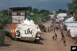 FILE - A UN armoured personnel vehicle stands in a refugee camp in Juba South Sudan.