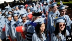 Students participate in a graduation ceremony at Columbia University in New York, May 17, 2017. (AP Photo/Seth Wenig)