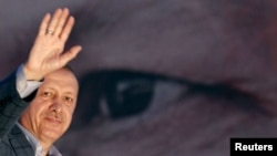 Turkey's Prime Minister Tayyip Erdogan waves to the crowd after he is elected president in a first-round victory, in Istanbul, Turkey, Aug. 10, 2014.