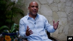 Former Haitian Prime Minister Laurent Lamothe speaks during an interview with Associated Press in Port-au-Prince, Dec. 15, 2014.