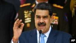Le président vénézuélien Nicolas Maduro donne une conférence de presse au palais présidentiel de Miraflores à Caracas, Venezuela, le jeudi 12 mars 2020. (Photo: Matias Delacroix/AP)
