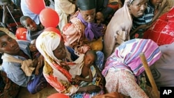 Women wait for medical care at Camp Seyidka, a camp for displaced people, in Mogadishu, Somalia, Aug. 19, 2011