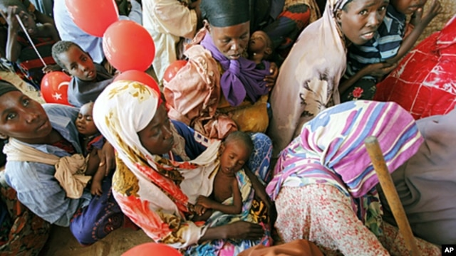 Women wait for medical care at Camp Seyidka, a camp for displaced people, in Mogadishu, Somalia, August 19, 2011