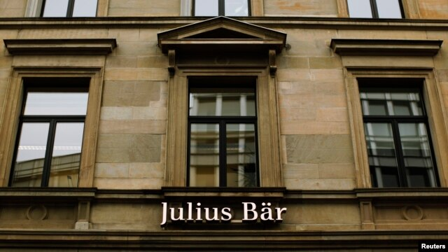 Swiss private bank Julius Baer, reported a slump in profits, is being investigated by U.S. authorities cracking down on tax evasion, Feb. 4, 2013.