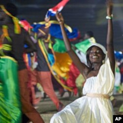 A woman dances as part of the opening ceremony celebration at the World Festival of Black Arts in Dakar