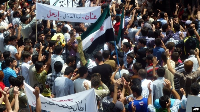 A handout image released by the Syrian opposition's Shaam News Network shows anti-regime demonstrators during a protest in Homs province, May 25 , 2012.
