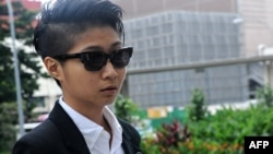 This photograph taken on April 2, 2013 shows Singaporean artist Samantha Lo Xin Hu, 26, arriving at the Subordinate courts in Singapore.