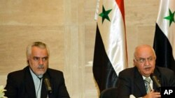 Syrian PM Mohammed Naji Otri (R) and Iran's First VP Mohammad Reza Rahimi (L) speak during a joint press conference after signing agreements in Damascus on 30 Apr 2010