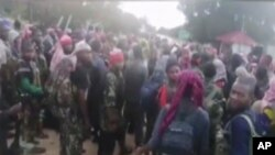 In this image taken from militant video released by the Islamic State group on Monday March 29, 2021, purporting to show fighters near the strategic north eastern Mozambique town of Palma, as the militant group claimed it had taken control of the…