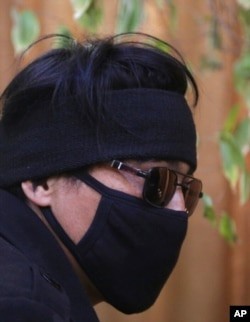 FILE - In this Feb. 26, 2019, photo, Abdullah, a former Afghan fighter in Syria with the Fatimiyoun Brigade, wears a mask to hide his identity during an interview with The Associated Press in Kabul, Afghanistan.