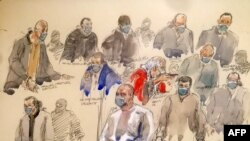 A courtroom sketch made on Dec. 14, 2020 shows Ali Riza Polat (C), believed to have been the right-hand man of Amedy Coulibaly, speaks in front of others defendants at Paris' courthouse, Dec. 14, 2020.