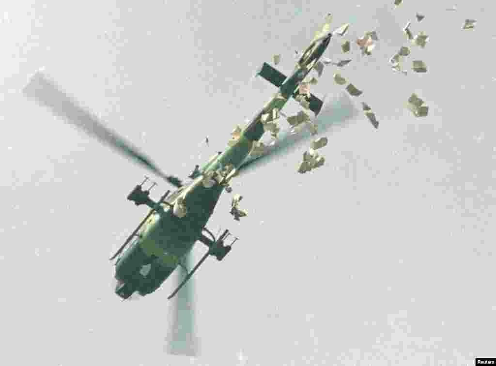 A military helicopter drops leaflets above Tiananmen Square, May 22, 1989.