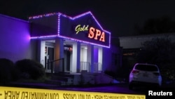 FILE - Crime scene tape surrounds Gold Spa after deadly shootings at a massage parlor and two day spas in the Atlanta area, in Atlanta, Georgia, March 16, 2021.