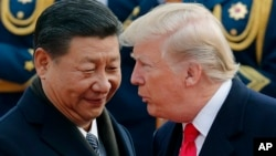 U.S. President Donald Trump, right, chats with Chinese President. (File)