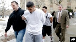 FILE - In this Jan. 11, 2018, photo, suspected members of the MS-13 gang are escorted to their arraignment in Mineola, N.Y.