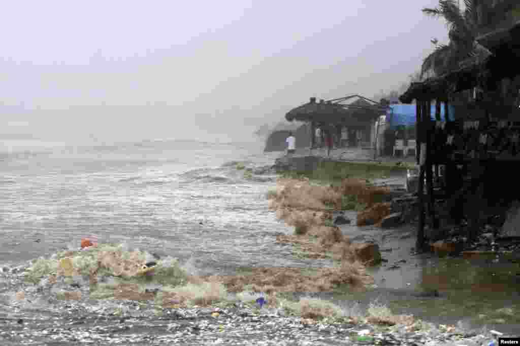 Waves flood a beach in Acapulco, Mexico, Sept. 15, 2013.