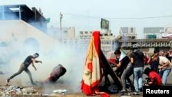 پولیس چارواکي وایي مظاهره کوونکي د بغداد مهمې لارې بندې کړې