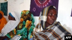 FILE - Hawo Jibril Ahmed (R), a former rape victim sits with other Somali women, inside the Somali women development center in Mogadishu, Dec. 31, 2012.