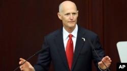 FILE - Gov. Rick Scott speaks to the Legislature, March 7, 2017, in Tallahassee, Fla.