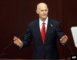 FILE - Gov. Rick Scott speaks to the Florida Legislature, March 7, 2017, in Tallahassee.