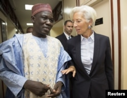International Monetary Fund Managing Director Christine Lagarde (R) walks with Cameroon's Minister of Finance Alamine Ousmane Mey after their meeting at the Ministry of Finance in Yaounde, Cameroon, in this Jan. 7, 2016 handout photo by IMF.