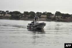 FILE - A boat of the Chadian police sailing on Lake Chad.