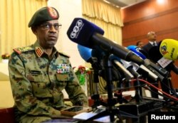 FILE - Major General Awad Mohamed Ahmed Ibn Auf, who was to lead a military council to run Sudan over the next two years, speaks to the media, in Khartoum, Sudan, Feb. 24, 2019.