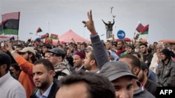 Người Libya ăn mừng tại quảng trường chính của Benghazi, phía đông Libya, ngày 18 tháng 3, 2011