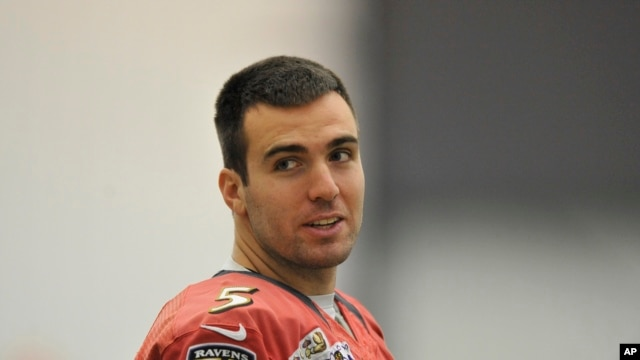 Baltimore Ravens quarterback Joe Flacco looks towards the media during football practice, Jan. 26, 2013 in Owings Mills, Md.