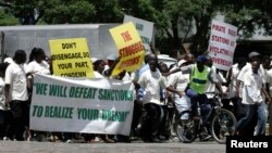 FILE - Supporters of the Zimbabwe African National Union's Patriotic Front (ZANU-PF) march in Harare, Feb. 24, 2010, to protest a European Union decision to extend economic sanctions on Zimbabwe.