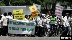 FILE: Zanu PF supporters marching in Harare.