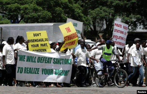 FILE - Supporters of the Zimbabwe African National Union's Patriotic Front (ZANU-PF) march in Harare to protest against a European Union decision to extend economic sanctions on Zimbabwe, Feb. 24, 2010.