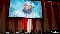 A previous address to the United Nations by former South African President Nelson Mandela is shown on a video screen during an informal meeting of the plenary of the General Assembly to commemorate Nelson Mandela International Day at the United Nations headquarters in New York, July 18, 2013.