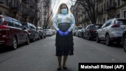 "Tiffany Pinckney poses for a portrait in the Harlem neighborhood of New York on April 1, 2020. Pinckney became one of the nations first donors of ""convalescent plasma."" (AP Photo/Marshall Ritzell)"