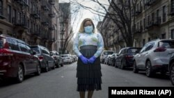 Tiffany Pinckney poses for a portrait in the Harlem neighborhood of New York on April 1, 2020.