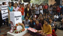 Indians gather next to a makeshift memorial to mourn the death of a 23-year-old gang rape victim, in Bangalore, India , Saturday, Dec. 29, 2012.