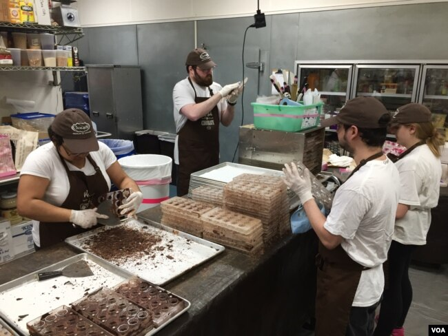 A team of workers make hand-crafted caramels in small batches at the Chouquette kitchen just outside Washington. (VOA Photo/J.Taboh)