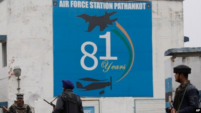 FILE - Indian soldiers stand guard outside an air base in Pathankot, India, Jan. 4, 2016.