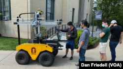 Students work together teaching an agricultural robot on the campus of Carnegie Mellon University in Pittsburgh.