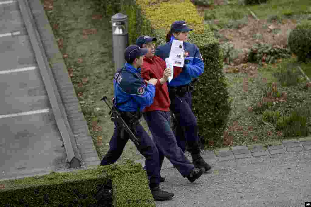 Police remove a protester near the Beau Rivage Palace Hotel where an extended round of talks on Iran's nuclear program is taking place, in Lausanne, April 2, 2015.